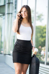 Businesswoman using a Cell Phone outoors