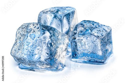 Leinwandbild Motiv Three ice cubes on white background.