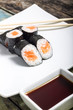Makisushi on white plate. Seafood traditional maki sushi rolls