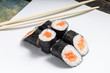 Seafood traditional maki sushi rolls with chopsticks