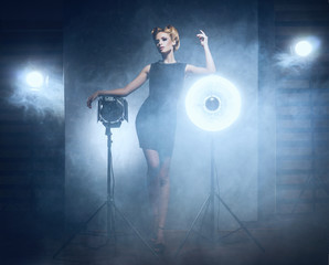 A woman in a fashion dress on a glamour background