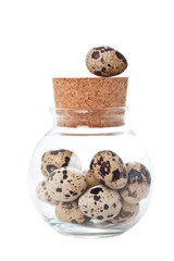 Quail eggs in a jar