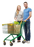 smiling couple with shopping cart and food in it