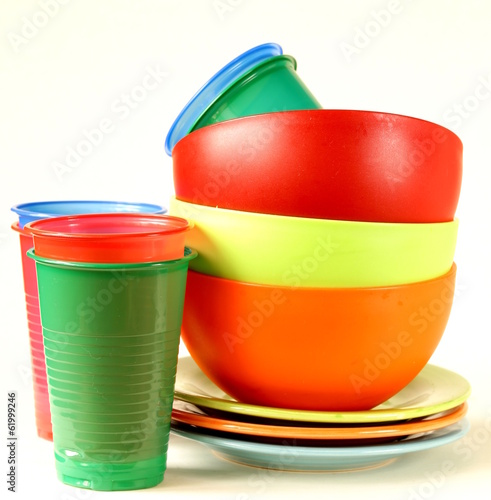 colored plastic tableware (cups, bowls, plates)