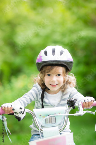 Happy kid sitting on the bike