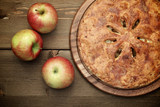 American apple pie on a wooden table, top view