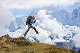 Hiker jumps in Himalaya mountains - 62000614