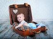 little boy in the old days a suitcase