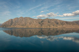 mountains reflecting in lake Hawea in New Zealand