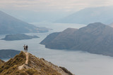 couple admiring lake Wanaka in New Zealand