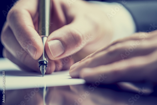 Retro image of a man writing a note