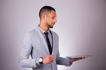 African American business man using a tactile tablet - Black peo