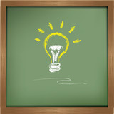 Lightbulb drawing on blackboard background