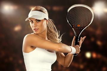 Beautiful woman enjoying the great game of tennis