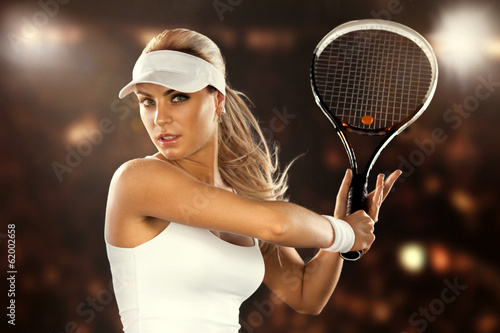 Beautiful woman enjoying the great game of tennis