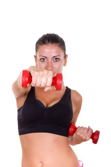 beautiful sporty woman exercising and lifting weights dumbbells