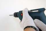 Electric drill touching wall, action concept