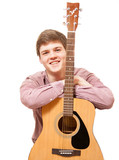 isolated portrait of smiling young man leaning against guitar