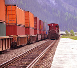 Two freight trains in Canadian rockies.