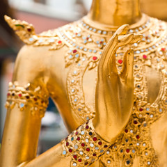 Blessing hand of Golden Kinnari statue. Bangkok, Thailand