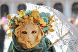 Female mask with umbrella at Carnival of Venice