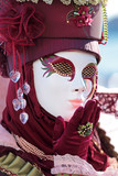 Red mask sending a kiss at Carnival of Venice