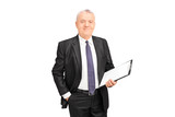 Mature businessman holding a clipboard