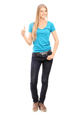 Full length portrait of casual young girl giving thumb up