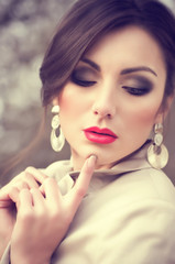 young woman with makeup and with jewelry precious decorations.