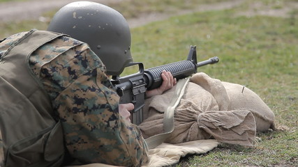 Soldier  shooting from M16 rifle