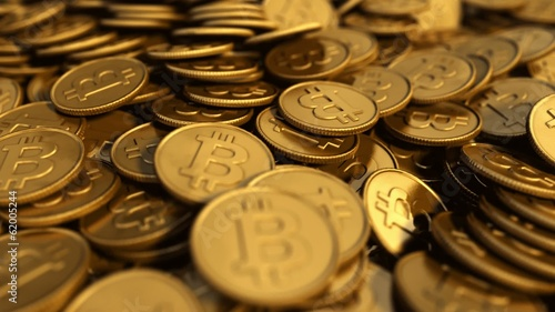 Close up of a symbolic slow rotating golden Bitcoin pile
