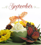 Happy September cupcake with autumn fall decorations