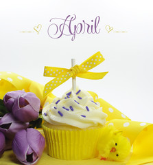 Happy April theme cupcake with yellow chick and tulips
