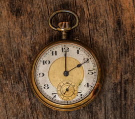 old clock vintage picture in wood background
