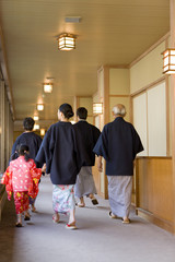 three-generation family in yukata coming to hot spring