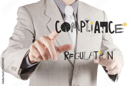 businessman hand pointing to Compliance Regulation designwords a