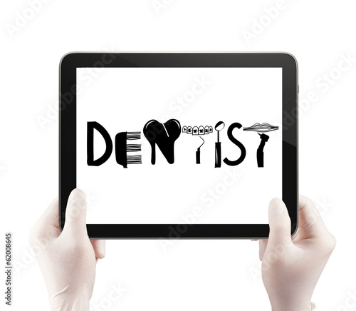 doctor hand hold tablet computer show design word DENTIST as con
