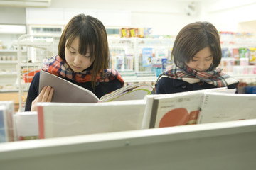 female high scool student browsing at convenience store