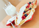 tasty sweet pancakes with berries and  milk