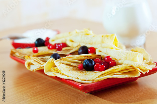 delicious pancakes with berries and dairy