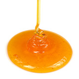Pouring Honey on White Background