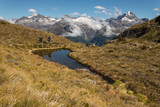 tourists hiking on Routeburn Track in Southern Alps