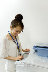 young woman photocopying