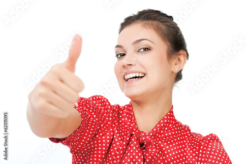 Attractive young business woman with thumb up