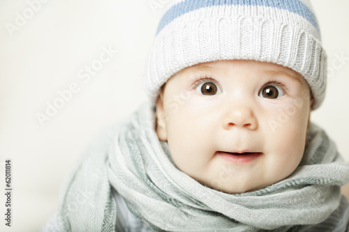 Small baby in blue cap, cute face