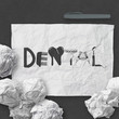 design word DENTAL on white crumpled paper and texture backgroun