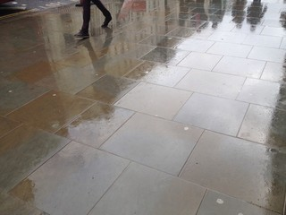 people walk on wet street in london