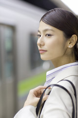 young business woman waiting for train on the platform