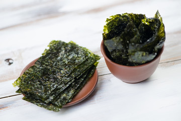 Sheets of nori, wooden background, horizontal shot