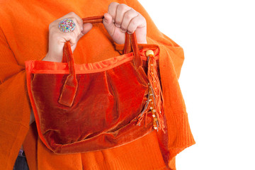 tunic and orange bag